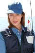 Portrait of woman with fishing rod