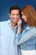 Woman pulling on her boyfriend's cheek