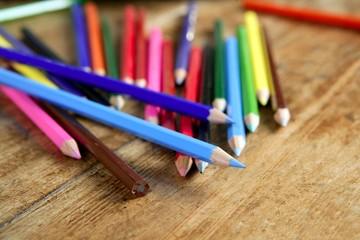 colorful pencil arrangement casual on wooden desk