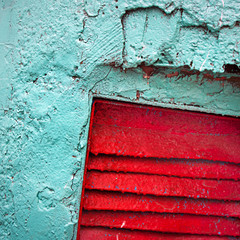 Grunge painted old wall with red