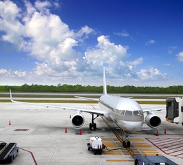 aircraft airplane plane landed airport blue sky