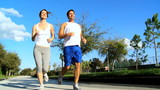 Young Couple Jogging on Suburban Roads