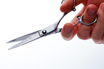 Scissors in male hand