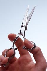 Scissors in male hand