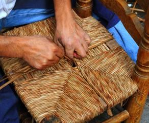 enea traditional spain reed chair handcraft man hands working