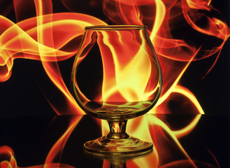 Brandy glass in fire flames