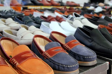 leather shoes retail shop in rows varied colors
