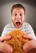 Man eating juicy hamburger