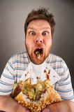 Dirty man chewing hamburger - Fine Art prints