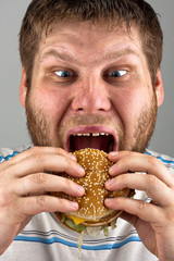 Man eating hamburger