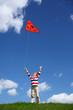 Boy starts air serpent of triangular form in sky