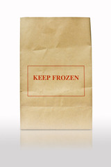 brown paper bag with keep frozen sign
