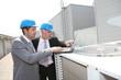 Businessmen on industrial site