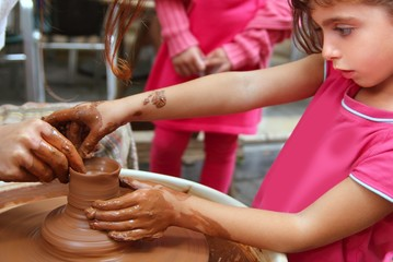 clay potter hands wheel pottery work workshop pupil