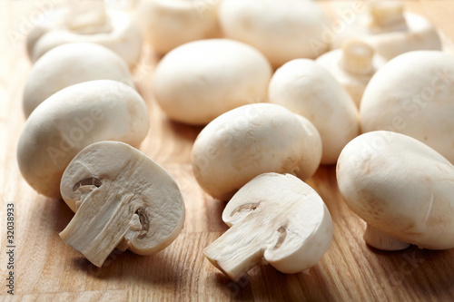 Champignon on wooden background