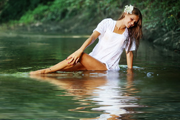 Beautiful girl in river