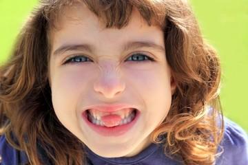 indented girl sticking tongue between teeth