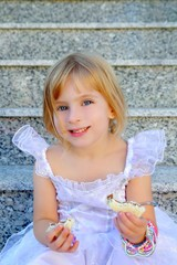 blond children princess girl eating chocolate sandwich