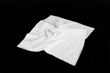 Napkin, A wrinkled napkin on black  screen.