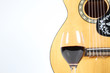 glass wine and guitar isolated on white