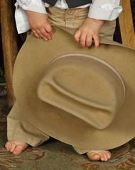Little Boy Holding Cowboy Hat