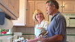 Mature couple doing dishes