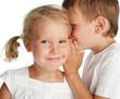 Boy whispers a secret