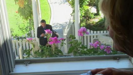 Older woman watching her husband return home