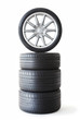 Isolated set of low profile summer tyres with one wheel on top