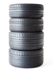 Set of summer tyres isolated on white fond