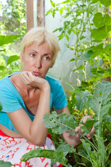 The young woman is upset-caterpillars eat leaves of plants