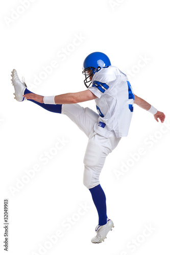 American football player kicking