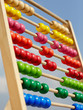 Coloured children abacus in front of blue sky