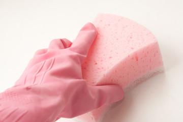 Hand in rubber glove holding sponge