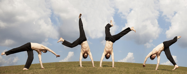 Men make acrobatic at meadow.