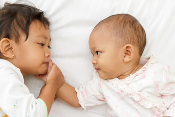 cute little girl and baby playing together