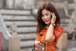asian woman phoning