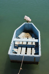 Old blue fishing boat floating on the water