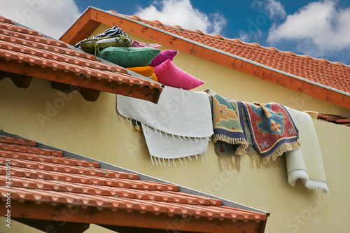 pillows and rugs lie on the tiled roof