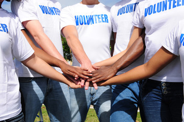 multi-ethnic volunteer group hands together