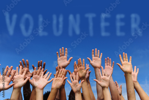 volunteer group raising hands