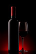 bottle with red wine and glass on a red gradient