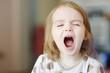 Little funny toddler girl screaming