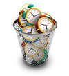 canvas print picture - Wasting time concept: alarm clocks in the trash bin