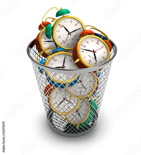 Wasting time concept: alarm clocks in the trash bin