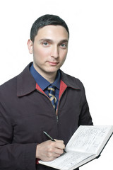 man in jacket and tie writing in his planner isolated on white