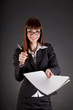 Cheerful businesswoman with documents and pen