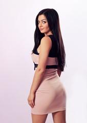 Sexy brunette in pink dress