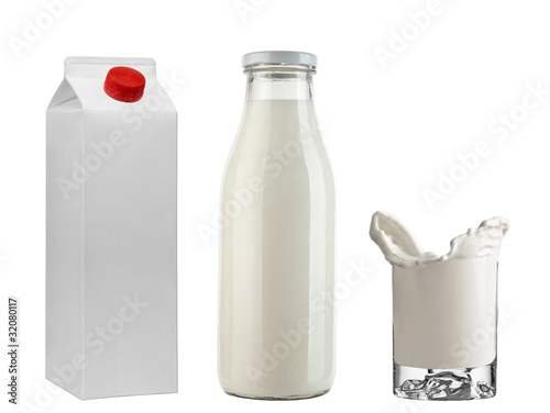 Bottle & tetrapak with milk + Freeze milk in glass isolated on w