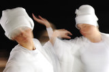 Artistic motion photo of white sufy female dancers poster
